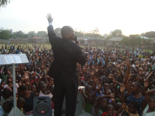 TANGO2 Feb12 Nkome 15.Preacher and crowd the first day of outreach MR